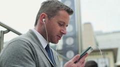 Businessman talking on cellphone, steadycam shot - stock footage