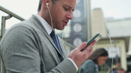Businessman talking on cellphone, steadycam shot Stock Footage