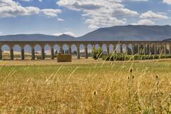 roman aqueduct at pamplona - stock photo