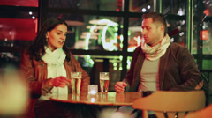 Couple having an argue at night in pub, steadycam shot Stock Footage