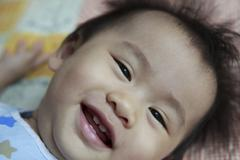 Close up smiling face of baby with four teeth Stock Photos