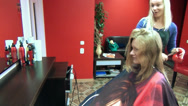 Stock Video Footage of Mirror and blond hair stylist woman at work cut girl hair