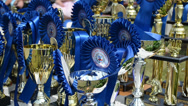 Stock Video Footage of Closeup of horse race cups awards trophy for winners