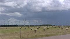 Wind Farm in polder along Dollart sea dike in countryside north of Emden Stock Footage