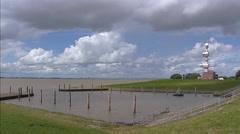 Knockster Tief waterway flowing into Dollard Bay + pan Bay , dark clouds Stock Footage