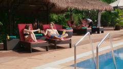 1of27 Young people relaxing in hotel swimming pool, gym, bar Stock Footage