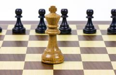 chess king against pawns - stock photo