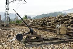 Old weathered rusty grungy railroad points switch - stock photo