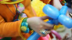 Clown making figures from balloons Stock Footage