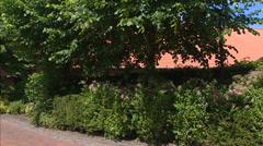 Cobbled street in rural village + pan Biergarten (Beer Garden) sign in street. Stock Footage