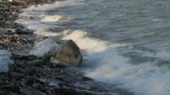 Strong waves crashing towards rocky shoreline Stock Footage