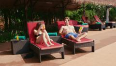 2of27 Young people relaxing in hotel swimming pool, gym, bar Stock Footage