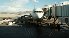 AIRPORT BAGGAGE HANDLING AT GATE Stock Footage