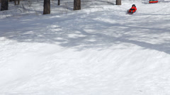 Happy child sledging in fresh snow in winter. Stock Footage
