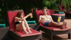 3of27 Young people relaxing in hotel swimming pool, gym, bar Stock Footage