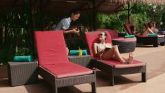 4of27 Young people relaxing in hotel swimming pool, gym, bar Stock Footage