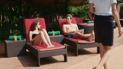 6of27 Young people relaxing in hotel swimming pool, gym, bar Stock Footage