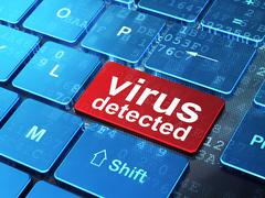 Safety concept: Virus Detected on computer keyboard background - stock illustration
