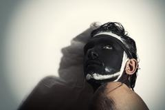Portrait of man with black theatrical makeup Stock Photos