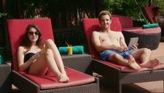 8of27 Young people relaxing in hotel swimming pool, gym, bar Stock Footage