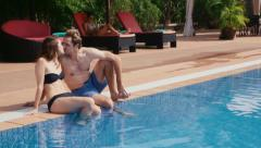 9of27 Young people relaxing in hotel swimming pool, gym, bar Stock Footage