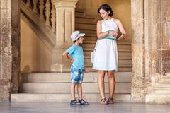 Mother and son visiting Alhambra palace - stock photo