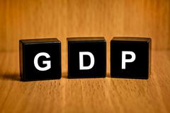 gross domestic product or gdp word on black block - stock photo