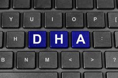Docosahexaenoic acid or dha word on keyboard Stock Photos