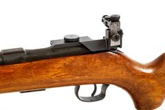 detail of old bolt action rifle isolated - stock photo