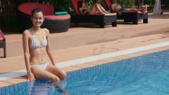11of27 Young people relaxing in hotel swimming pool, gym, bar Stock Footage