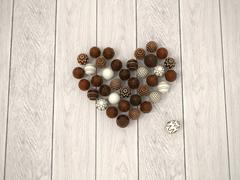 Chocolate easter eggs heart on white wooden floor - top view Stock Illustration