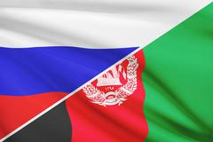 flag of russia and afghanistan blowing in the wind. part of a series. - stock illustration