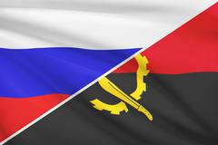 Flag of russia and angola blowing in the wind. part of a series. Stock Illustration