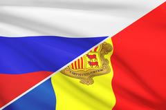 flag of russia and andorra blowing in the wind. part of a series. - stock illustration