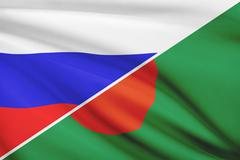 flag of russia and bangladesh blowing in the wind. part of a series. - stock illustration