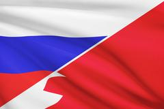 flag of russia and bahrain blowing in the wind. part of a series. - stock illustration