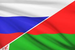 flag of russia and belarus blowing in the wind. part of a series. - stock illustration