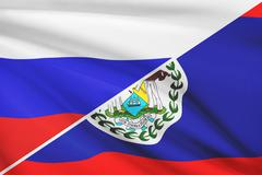 Flag of russia and belize blowing in the wind. part of a series. Stock Illustration