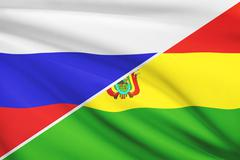 Flag of russia and bolivia blowing in the wind. part of a series. Stock Illustration