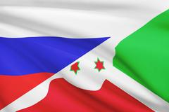 flag of russia and burundi blowing in the wind. part of a series. - stock illustration