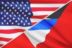 Flags of usa and antigua and barbuda blowing in the wind. part of a series. Stock Illustration