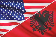 Flags of usa and albania blowing in the wind. part of a series. Stock Illustration