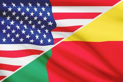 flags of usa and benin blowing in the wind. part of a series. - stock illustration