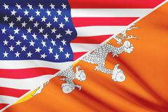 flags of usa and bhutan blowing in the wind. part of a series. - stock illustration