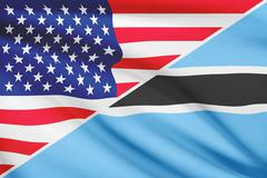 Flags of usa and botswana blowing in the wind. part of a series. Stock Illustration