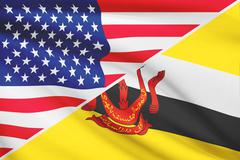 Flags of usa and brunei blowing in the wind. part of a series. Stock Illustration