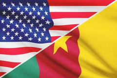 flags of usa and cameroon blowing in the wind. part of a series. - stock illustration