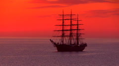 Three-masted full-rigged tall ship in sunrise - stock footage