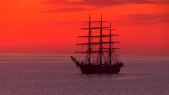 Stock Video Footage of Three-masted full-rigged tall ship in sunrise