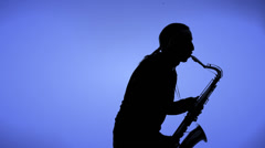 Man playing sax in silhouette Stock Footage